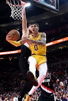 Nov 3, 2018; Portland, OR, USA; Los Angeles Lakers forward Kyle Kuzma (0) drives to the basket on Portland Trail Blazers center Jusuf Nurkic (27) during the second half of the game at the Moda Center. The Lakers won the game 114-110. Mandatory Credit: Steve Dykes-USA TODAY Sports