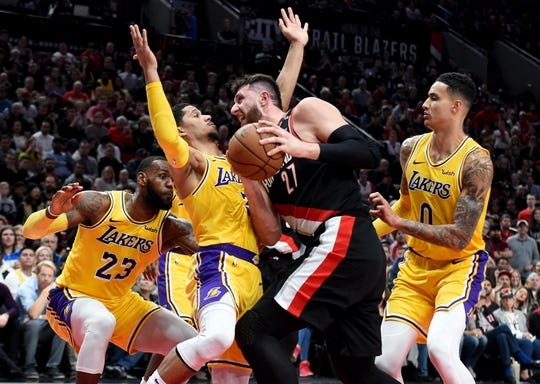 Nov 3, 2018; Portland, OR, USA; Portland Trail Blazers center Jusuf Nurkic (27) drives to the basket on Los Angeles Lakers guard Josh Hart (3) as forward LeBron James (23) and forward Kyle Kuzma (0) close in during the second half of the game at the Moda Center. The Lakers won the game 114-110. Mandatory Credit: Steve Dykes-USA TODAY Sports