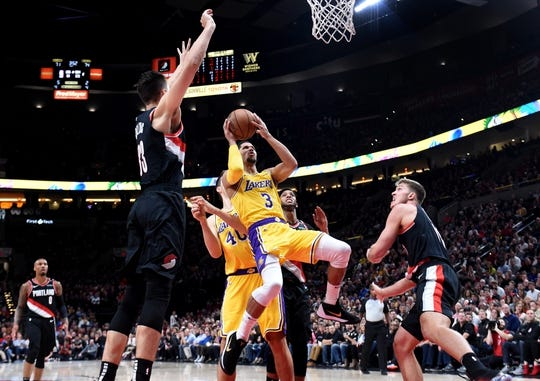 Nov 3, 2018; Portland, OR, USA; Los Angeles Lakers guard Josh Hart (3) shoots the ball over Portland Trail Blazers forward Zach Collins (33) and forward Meyers Leonard (11) during the second half of the game at the Moda Center. The Lakers won the game 114-110. Mandatory Credit: Steve Dykes-USA TODAY Sports