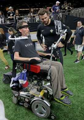 Nov 4, 2018; New Orleans, LA, USA; New Orleans Saints punter Thomas Morstead talks to former Saints safety Steve Gleason before their game against the Los Angeles Rams at the Mercedes-Benz Superdome. Mandatory Credit: Chuck Cook-USA TODAY Sports