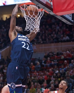 Nov 4, 2018; Portland, OR, USA; Minnesota Timberwolves forward Andrew Wiggins (22) dunks over Portland Trail Blazers guard CJ McCollum (3) during the first quarter at the Moda Center. Mandatory Credit: Craig Mitchelldyer-USA TODAY Sports