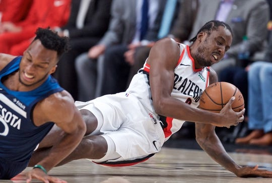 Nov 4, 2018; Portland, OR, USA; Portland Trail Blazers forward Al-Farouq Aminu (8) and Minnesota Timberwolves guard Josh Okogie (20) dive for a loose ball during the first quarter at the Moda Center. Mandatory Credit: Craig Mitchelldyer-USA TODAY Sports