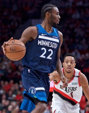 Nov 4, 2018; Portland, OR, USA; Minnesota Timberwolves forward Andrew Wiggins (22) dribbles past Portland Trail Blazers guard CJ McCollum (3) during the first quarter at the Moda Center. Mandatory Credit: Craig Mitchelldyer-USA TODAY Sports