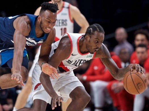 Nov 4, 2018; Portland, OR, USA; Portland Trail Blazers forward Al-Farouq Aminu (8) and Minnesota Timberwolves guard Josh Okogie (20) reach for a loose ball during the first quarter at the Moda Center. Mandatory Credit: Craig Mitchelldyer-USA TODAY Sports