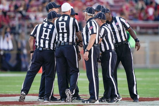 Oct 27, 2018; Stanford, CA, USA; Referees gather together before the game between the Stanford Cardinal and the Washington State Cougars at Stanford Stadium. Mandatory Credit: Stan Szeto-USA TODAY Sports