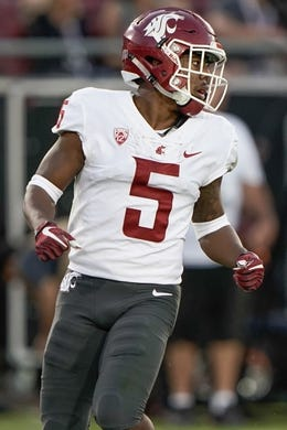 Oct 27, 2018; Stanford, CA, USA; Washington State Cougars wide receiver Travell Harris (5) looks for the ball against the Stanford Cardinal during the third quarter at Stanford Stadium. Mandatory Credit: Stan Szeto-USA TODAY Sports