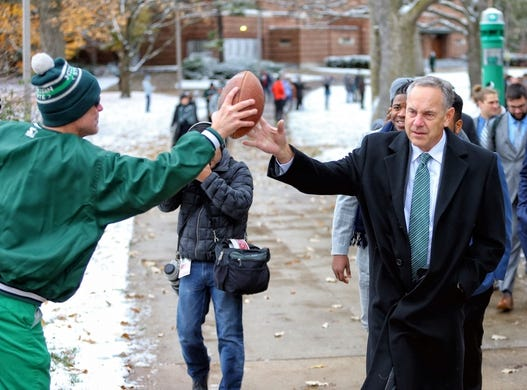 Nov 10, 2018; East Lansing, MI, USA; Michigan State Spartans head coach Mark Dantonioi interacts with fan on walk to Spartan Stadium prior to a game against the Ohio State Buckeyes at Spartan Stadium. Mandatory Credit: Mike Carter-USA TODAY Sports