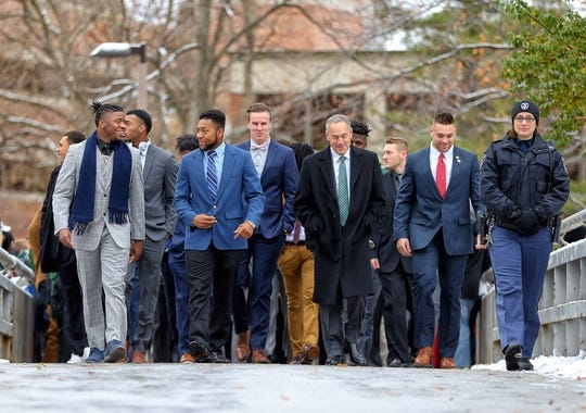 Nov 10, 2018; East Lansing, MI, USA; Michigan State Spartans head coach Mark Dantonio walks his team though campus to Spartan Stadium prior to a game against the Ohio State Buckeyes at Spartan Stadium. Mandatory Credit: Mike Carter-USA TODAY Sports