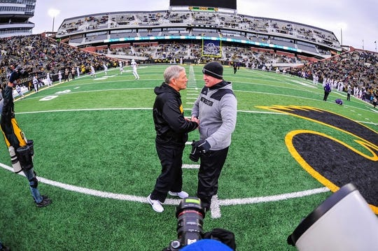 Nov 10, 2018; Iowa City, IA, USA; Iowa Hawkeyes head coach Kirk Ferentz (left) and Northwestern Wildcats head coach Pat Fitzgerald (right) shake hands before a game at Kinnick Stadium. Mandatory Credit: Jeffrey Becker-USA TODAY Sports