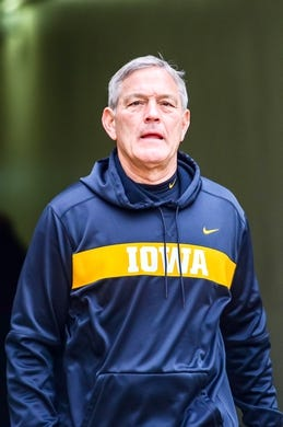 Nov 10, 2018; Iowa City, IA, USA; Iowa Hawkeyes head coach Kirk Ferentz enters the field before a game against the Northwestern Wildcats at Kinnick Stadium. Mandatory Credit: Jeffrey Becker-USA TODAY Sports