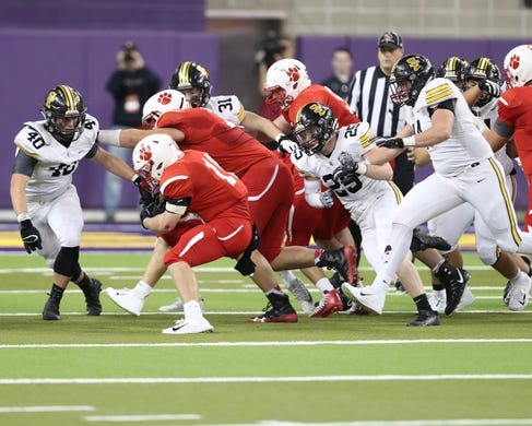 Nov 9, 2018; Cedar Falls, IA, USA;  The Cedar Falls Tigers Logan Wolf (17) is surrounded by the Southeast Polk Rams defense at the UNI Dome.  The Rams lost to the Tigers 26-12.  Ncaa Football Texas Tech At Iowa State