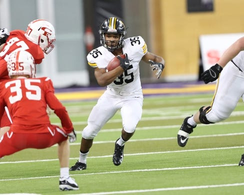 Nov 9, 2018; Cedar Falls, IA, USA; Southeast Polk Rams Deveyon Montgomery (35) looks for running room against the Cedar Falls Tigers at UNI Dome. The Rams lost to the Tigers 26-12.  Ncaa Football Texas Tech At Iowa State