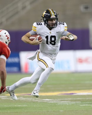 Nov 9, 2018; Cedar Falls, IA, USA; Southeast Polk Rams Josiah Cole (18) runs for a first down against the Cedar Falls Tigers at UNI Dome. The Rams lost to the Tigers 26-12.  Ncaa Football Texas Tech At Iowa State