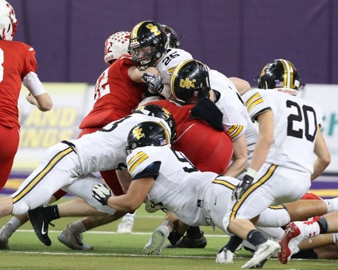 Nov 9, 2018; Cedar Falls, IA, USA; Cedar Falls Tigers Sam Gary (19) is gang tackled by the Southeast Polk Rams defense at the UNI Dome. The Rams lost to the Tigers 26-12.  Ncaa Football Texas Tech At Iowa State