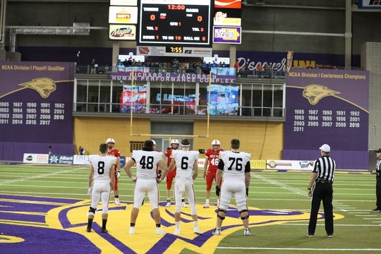 Nov 9, 2018; Cedar Falls, IA, USA; The Southeast Polk Rams and Cedar Falls Tigers captains meet for the coin toss at the UNI Dome. The Rams lost to the Tigers 26-12.  Ncaa Football Texas Tech At Iowa State