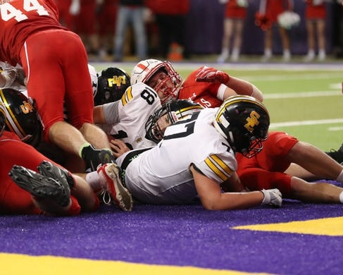 Nov 9, 2018; Cedar Falls, IA, USA; Southeast Polk Rams Josiah Cole (18) scores TD for the Rams against the Cedar Falls Tigers at the UNI Dome. The Rams lost to the Tigers 26-12.  Ncaa Football Texas Tech At Iowa State