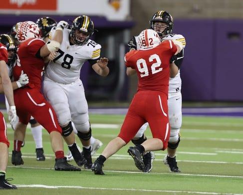 Nov 9, 2018; Cedar Falls, IA, USA;  Southeast Polk Rams Josiah Rowland (76) and Southeast Polk Rams Jack Wilty (78) battle the tough defense of the Cedar Falls Tigers at the UNI Dome. The Rams lost to the Tigers 26-12.  Ncaa Football Texas Tech At Iowa State