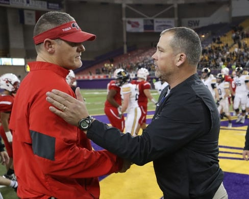Nov 9, 2018; Cedar Falls, IA, USA; Cedar Falls Tigers head coach Brad Remmert and Southeast Polk Rams head coach Brad Zelenovich talk after their semi-final game at the UNI Dome. The Rams lost to the Tigers 26-12.  Ncaa Football Texas Tech At Iowa State