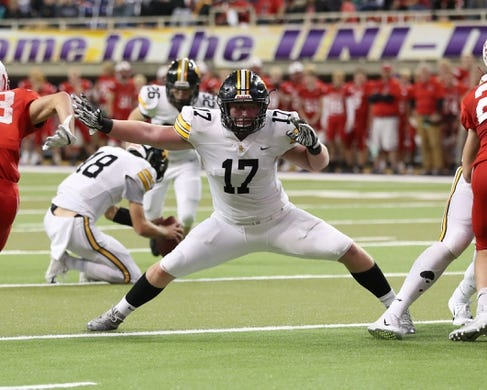 Nov 9, 2018; Cedar Falls, IA, USA; Southeast Polk Rams Scott Bell (17) blocks for the kick against the Cedar Falls Tigers at the UNI Dome. The Rams lost to the Tigers 26-12.  Ncaa Football Texas Tech At Iowa State