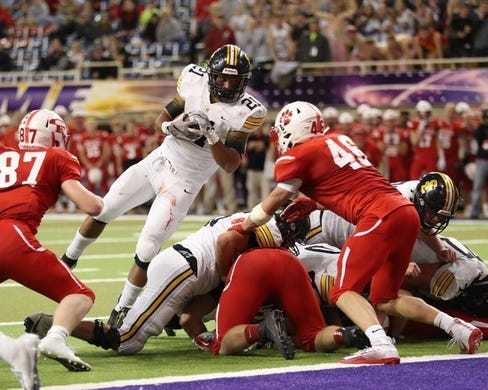 Nov 9, 2018; Cedar Falls, IA, USA; Southeast Polk Rams Gavin Williams (21) is stopped by Cedar Falls Tigers Jack Campbell (46) at the UNI Dome. The Rams lost to the Tigers 26-12.  Ncaa Football Texas Tech At Iowa State
