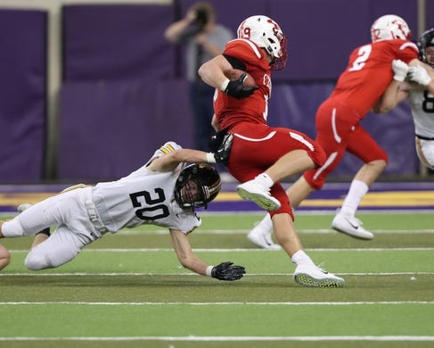 Nov 9, 2018; Cedar Falls, IA, USA; Cedar Falls Tigers Sam Gary (19) escapes the grasp of Southeast Polk Rams Eli Reed (20) at the UNI Dome. The Rams lost to the Tigers 26-12.  Ncaa Football Texas Tech At Iowa State