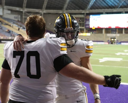 Nov 9, 2018; Cedar Falls, IA, USA; Southeast Polk Rams Gabe Hassman (70) and Southeast Polk Rams Dylan Travis (6) embrace after loosing to the Cedar Falls Tigers  at the UNI Dome. The Rams lost to the Tigers 26-12.  Ncaa Football Texas Tech At Iowa State