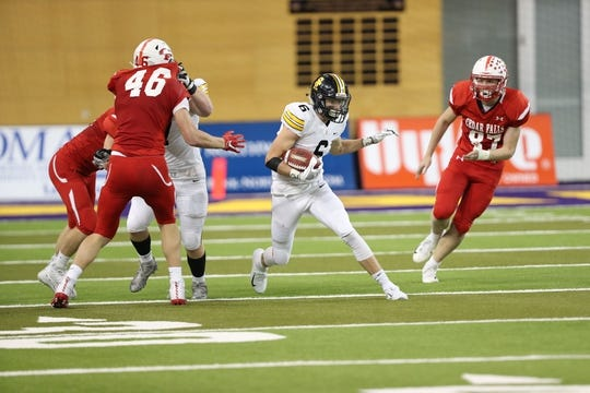 Nov 9, 2018; Cedar Falls, IA, USA; Southeast Polk Rams Dylan Travis (6) looks for running room against the Cedar Falls Tigers at the UNI Dome. The Rams lost to the Tigers 26-12.  Ncaa Football Texas Tech At Iowa State