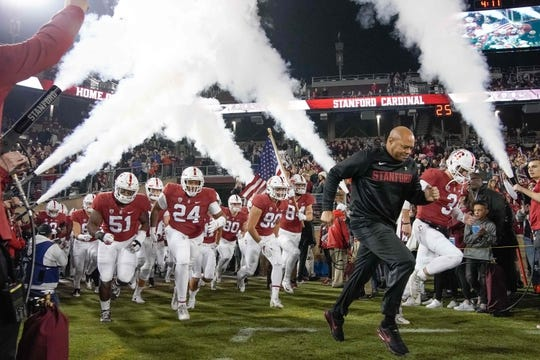 Nov 10, 2018; Stanford, CA, USA; Stanford Cardinal head coach David Shaw runs onto the field with his players before the game against the Oregon State Beavers at Stanford Stadium. Mandatory Credit: Stan Szeto-USA TODAY Sports