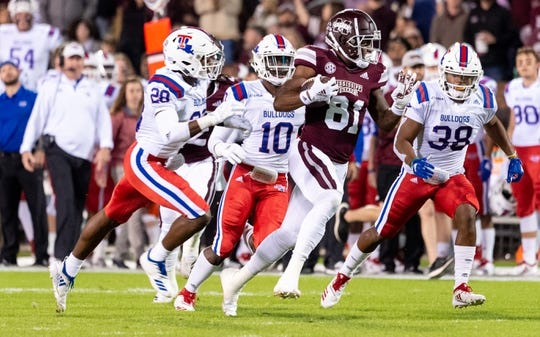Nov 3, 2018; Starkville, MS, USA; Mississippi State Bulldogs tight end Justin Johnson (81) against the Louisiana Tech Bulldogs during the first half at Davis Wade Stadium. Trailing on the play are Louisiana Tech Bulldogs defensive backs Jordan Baldwin (28) and James Jackson (10) and Darryl Lewis (38). Mandatory Credit: Vasha Hunt-USA TODAY Sports