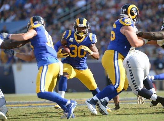 November 11, 2018; Los Angeles, CA, USA; Los Angeles Rams running back Todd Gurley (30) runs the ball against the Seattle Seahawks during the first half at the Los Angeles Memorial Coliseum. Mandatory Credit: Gary A. Vasquez-USA TODAY Sports