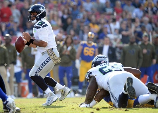 November 11, 2018; Los Angeles, CA, USA; Seattle Seahawks quarterback Russell Wilson (3) drops back to pass against the Los Angeles Rams during the first half at the Los Angeles Memorial Coliseum. Mandatory Credit: Gary A. Vasquez-USA TODAY Sports
