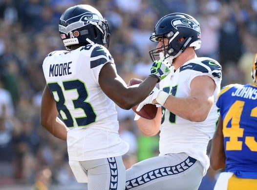 November 11, 2018; Los Angeles, CA, USA; Seattle Seahawks tight end Nick Vannett (81) celebrates with wide receiver David Moore (83) his touchdown scored against the Los Angeles Rams during the first half at the Los Angeles Memorial Coliseum. Mandatory Credit: Gary A. Vasquez-USA TODAY Sports