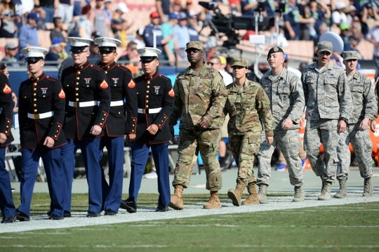 November 11, 2018; Los Angeles, CA, USA; Military personnel on field before the Los Angeles Rams play against the Seattle Seahawks at the Los Angeles Memorial Coliseum. Mandatory Credit: Gary A. Vasquez-USA TODAY Sports