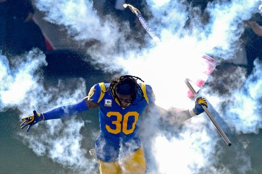 Nov 11, 2018; Los Angeles, CA, USA; Los Angeles Rams running back Todd Gurley (30) runs on to the field for the game against the Seattle Seahawks as the Memorial Coliseum. Mandatory Credit: Jayne Kamin-Oncea-USA TODAY Sports