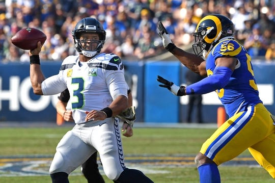 Nov 11, 2018; Los Angeles, CA, USA;    Los Angeles Rams defensive end Dante Fowler (56) pressures Seattle Seahawks quarterback Russell Wilson (3) to throw an incomplete pass in the first half at the Memorial Coliseum. Mandatory Credit: Jayne Kamin-Oncea-USA TODAY Sports
