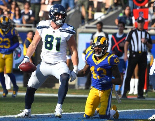 Nov 11, 2018; Los Angeles, CA, USA;  Los Angeles Rams strong safety John Johnson (43) looks on after Seattle Seahawks tight end Nick Vannett (81) scored a touchdown in the first half of the game at the Memorial Coliseum. Mandatory Credit: Jayne Kamin-Oncea-USA TODAY Sports