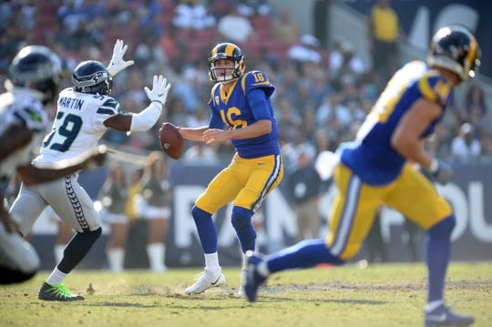 November 11, 2018; Los Angeles, CA, USA; Los Angeles Rams quarterback Jared Goff (16) drops back as Seattle Seahawks linebacker Jake Martin (59) moves in during the first half at the Los Angeles Memorial Coliseum. Mandatory Credit: Gary A. Vasquez-USA TODAY Sports