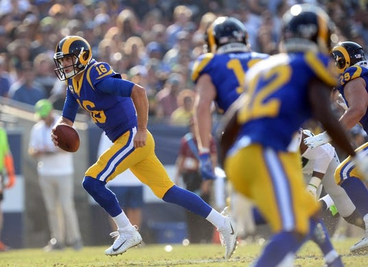 November 11, 2018; Los Angeles, CA, USA; Los Angeles Rams quarterback Jared Goff (16) runs the ball against the Seattle Seahawks during the second half at the Los Angeles Memorial Coliseum. Mandatory Credit: Gary A. Vasquez-USA TODAY Sports