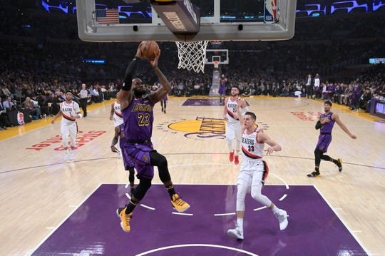Nov 14, 2018; Los Angeles, CA, USA; Los Angeles Lakers forward LeBron James (23) dunks the ball as Portland Trail Blazers forward Zach Collins (33) defends in the second quarter at Staples Center. Mandatory Credit: Kirby Lee-USA TODAY Sports