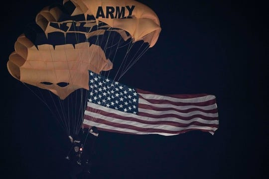 Nov 10, 2018; Stanford, CA, USA; The United States Army Parachute Team flies the American Flag down into Stanford Stadium before the game between the Stanford Cardinal and the Oregon State Beavers. Mandatory Credit: Stan Szeto-USA TODAY Sports