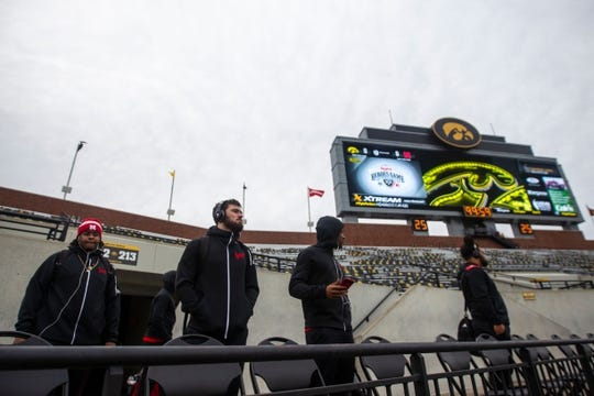 Nebraska players look out at the stadium after unloading from their bus before a Big Ten Conference NCAA football game on Friday, Nov. 23, 2018, at Kinnick Stadium in Iowa City.  181123 Iowa Nebraska 090 Jpg