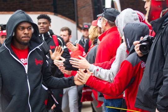 Nebraska players high-five fans while entering the stadium before a Big Ten Conference NCAA football game on Friday, Nov. 23, 2018, at Kinnick Stadium in Iowa City.  181123 Iowa Nebraska 091 Jpg