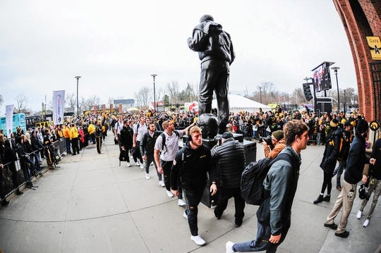 Nov 23, 2018; Iowa City, IA, USA; The Iowa Hawkeyes enter Kinnick Stadium before a game against the Nebraska Cornhuskers. Mandatory Credit: Jeffrey Becker-USA TODAY Sports