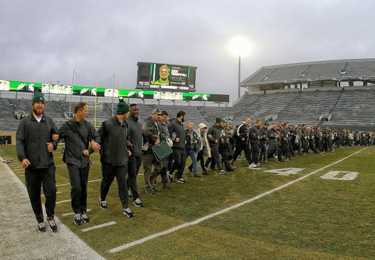 Nov 24, 2018; East Lansing, MI, USA; Michigan State Spartans walk the field as a team prior to a game against the Rutgers Scarlet Knights at Spartan Stadium. Mandatory Credit: Mike Carter-USA TODAY Sports