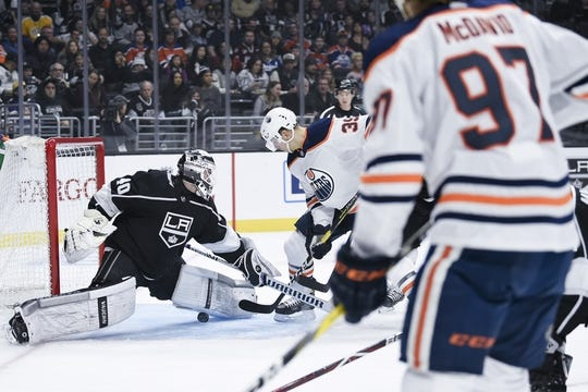 Nov 25, 2018; Los Angeles, CA, USA; Edmonton Oilers center Connor McDavid (97) watches after a pass to right wing Alex Chiasson (39) for a goal during the first period against the Los Angeles Kings at Staples Center. Mandatory Credit: Kelvin Kuo-USA TODAY Sports