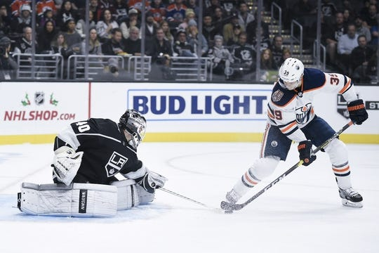 Nov 25, 2018; Los Angeles, CA, USA; Edmonton Oilers right wing Alex Chiasson (39) attempts to handle the puck while Los Angeles Kings goalie Cal Petersen (40) defends during the first period at Staples Center. Mandatory Credit: Kelvin Kuo-USA TODAY Sports
