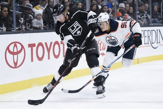 Nov 25, 2018; Los Angeles, CA, USA; Los Angeles Kings defenseman Paul LaDue (2) passes the puck while under pressure by Edmonton Oilers right wing Jesse Puljujarvi (98) during the first period at Staples Center. Mandatory Credit: Kelvin Kuo-USA TODAY Sports