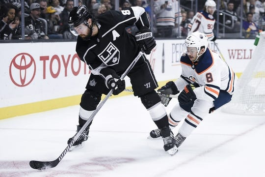 Nov 25, 2018; Los Angeles, CA, USA; Los Angeles Kings defenseman Drew Doughty (8) handles the puck while under pressure by Edmonton Oilers right wing Ty Rattie (8) during the first period at Staples Center. Mandatory Credit: Kelvin Kuo-USA TODAY Sports