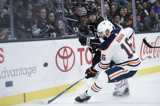Nov 25, 2018; Los Angeles, CA, USA; Los Angeles Kings center Anze Kopitar (11) passes the puck while Edmonton Oilers left wing Jujhar Khaira (16) defends during the first period at Staples Center. Mandatory Credit: Kelvin Kuo-USA TODAY Sports