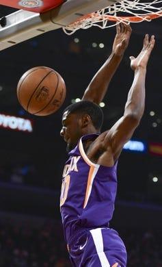Dec 2, 2018; Los Angeles, CA, USA; Phoenix Suns forward Josh Jackson (20) dunks during the first quarter against the Los Angeles Lakers at Staples Center. Mandatory Credit: Robert Hanashiro-USA TODAY Sports